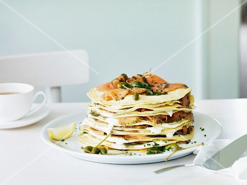 A stack of crêpes with smoked salmon and capers for Easter