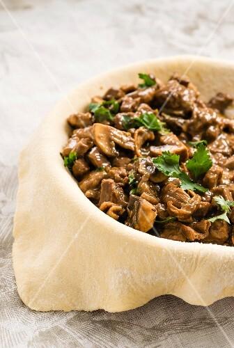 Beef and mushroom pie, unbaked