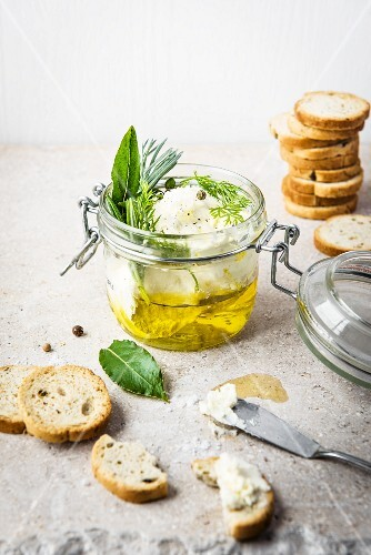 Homemade ricotta and olive oil with fresh herbs and bread crisps