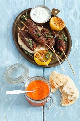 Cevapcici (mined lamb kebabs) with pita bread and ajvar