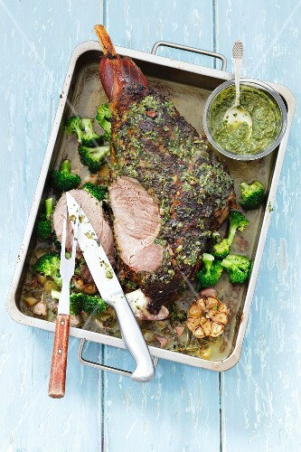 Slow roasted leg of lamb with pesto and broccoli