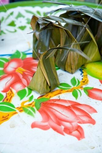 Thai dessert parcels made from banana leaves