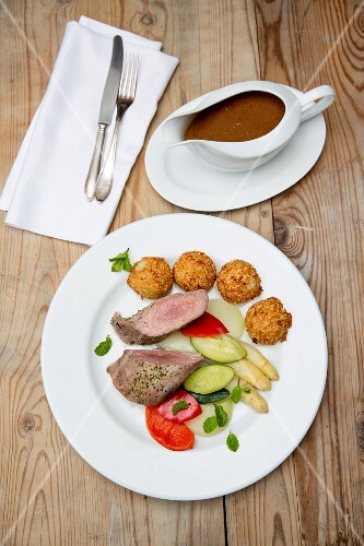 Pork fillet with vegetables and croquettes
