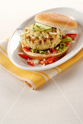 A fish burger with Emmental cheese