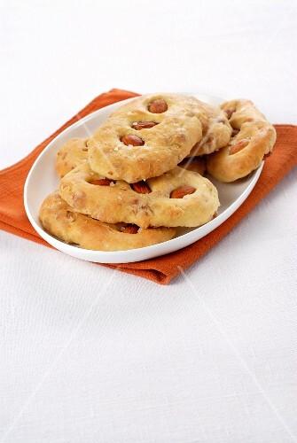 Mini focaccia with pancetta and almonds