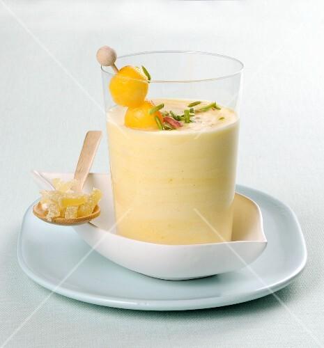 A mango yoghurt smoothie in a glass
