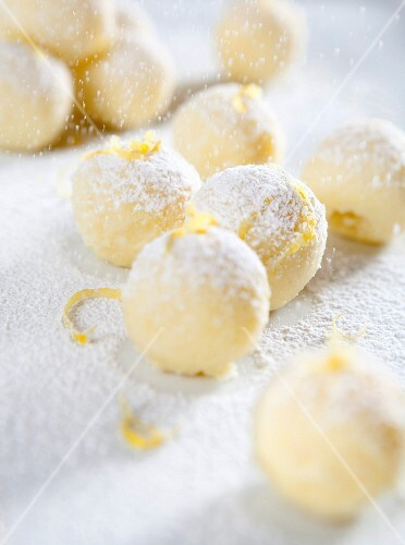 White chocolate truffles with lemon zest and icing sugar