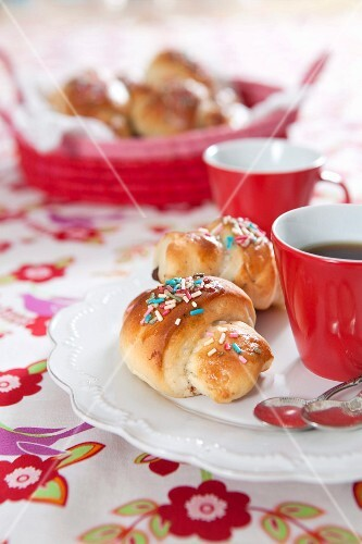 Cinnamon buns with colourful sugar sprinkles