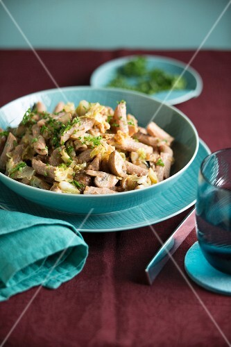 Penne pasta with Chinese cabbage and creamy mushroom sauce