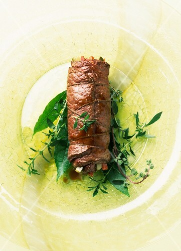 Beef roulade on fresh herbs