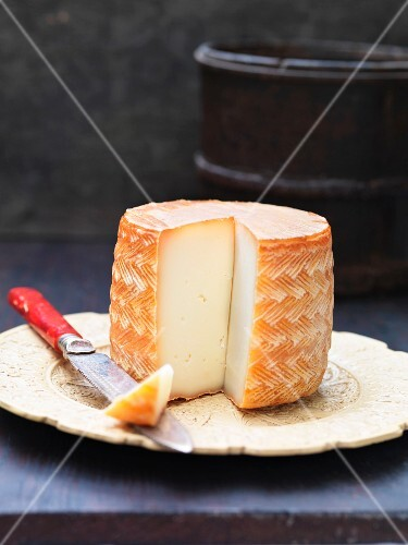 Manchego cheese, sliced on a plate
