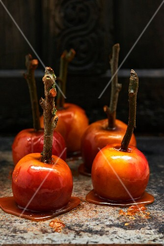 Toffee apples on a marble platter