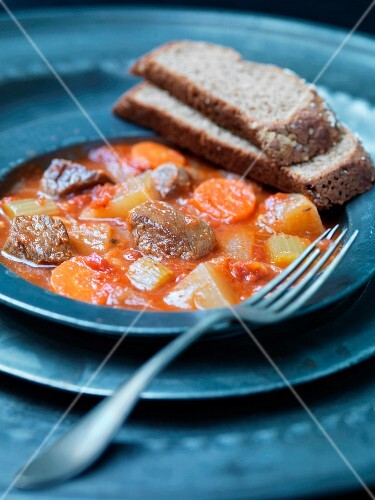 Navarin (braised lamb, France) with vegetables and bread
