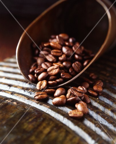 Fresh coffee beans in a vintage scoop