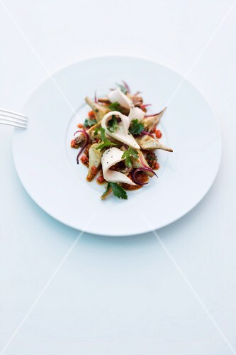 Warm artichoke salad with rabbit and a vegetable vinaigrette