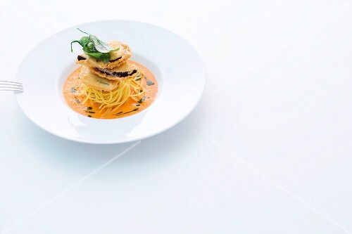 Aubergine piccata on linguine and a pepper sauce