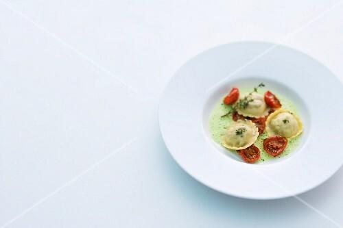 Lamb ravioli with tomatoes on herb foam