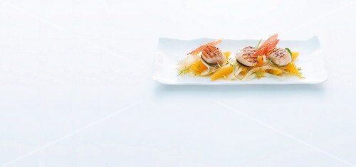 Grilled scallops with fennel and orange salad and Parma ham