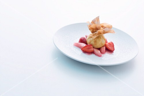 A mini strudel parcel with almond quark on rhubarb and strawberries