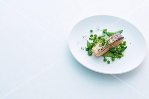 Wild salmon fillet on mushy peas