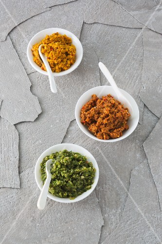 Yellow, red and green curry pastes