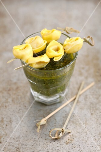 Mini tortellini skewers with basil sauce