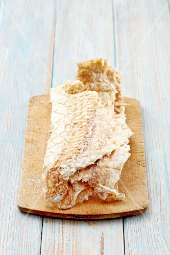 Icelandic dried fish on a wooden board