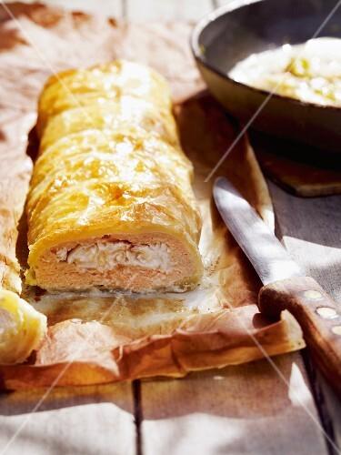 Salmon strudel on baking paper