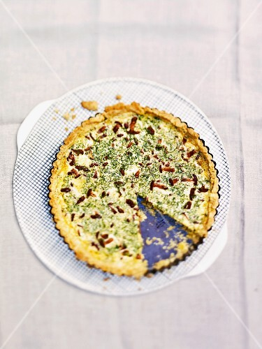 Herb quiche with mushrooms, sliced