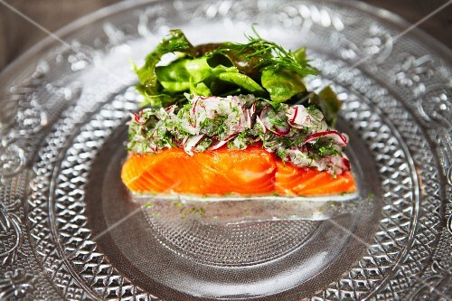 Salmon with a herb and radish crust and a salad garnish