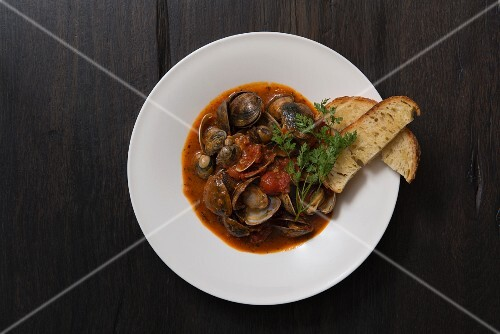 Clams in a spicy tomato broth with crostini