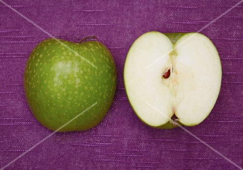 A halved Granny Smith apple