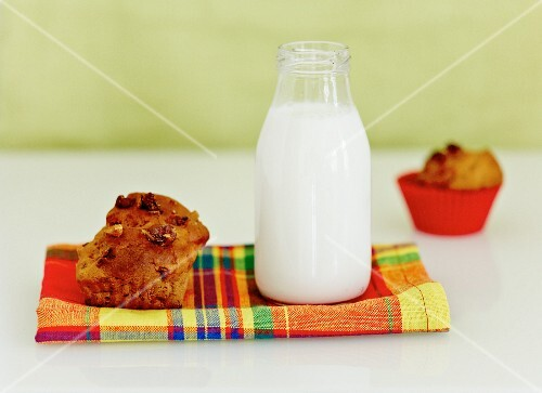 A bottle of milk and a banana and walnut muffin