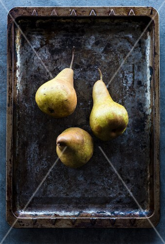 Three pears on and old baking tray