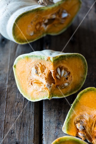 Sliced pumpkin on a wooden surface