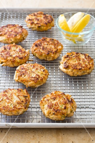Crab cakes on a cooling rack on a baking tray
