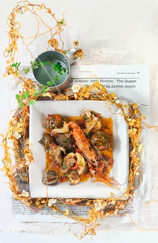 Mushroom stew with meatballs, scampi and squid