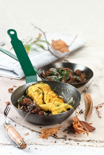 Omelette with morel mushrooms and fried chanterelle mushrooms