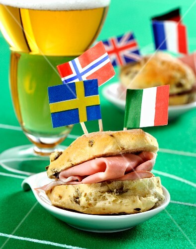 Focaccine alle olive (olive bread rolls) with mortadella, flags and football decorations