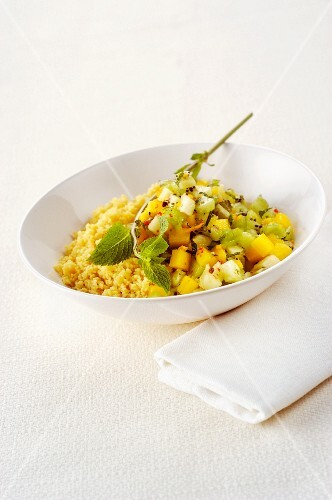 Fruit salad with couscous and peppermint