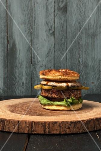 A vegetarian quinoa burger on a slice of wood