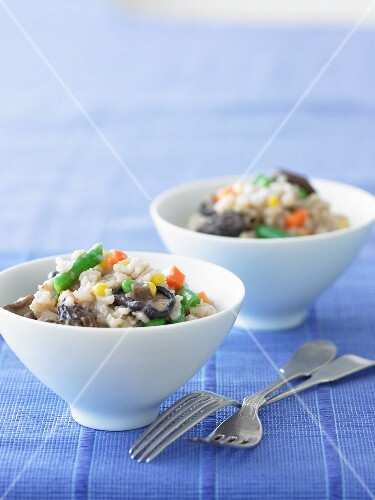 Brown rice risotto with vegetables and mushrooms