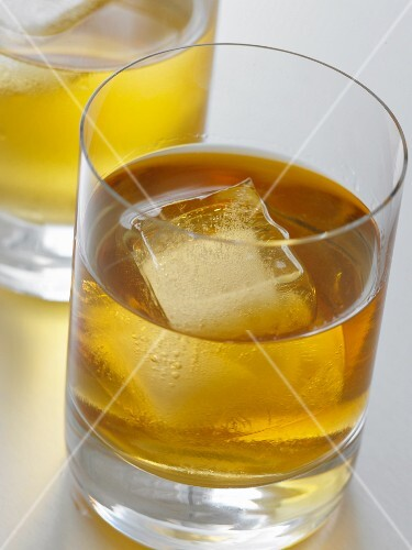 A drink with ice cubes and lemon