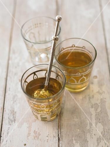 Oriental tea glasses with a tea infuser