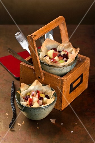 Filo pastry bowls filled with apples, lingonberries, vanilla syrup and spices
