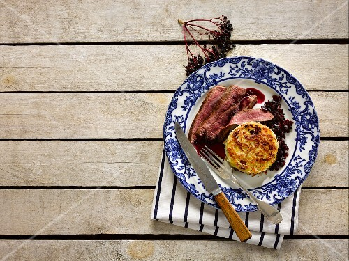 Venison with leek and potato fritters