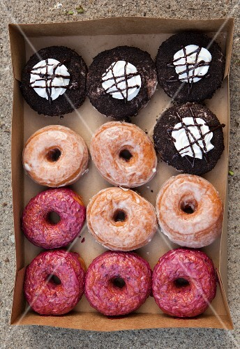 Various doughnuts in a box (seen from above)