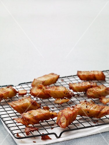 Slices of fried potato gratin on a wire rack