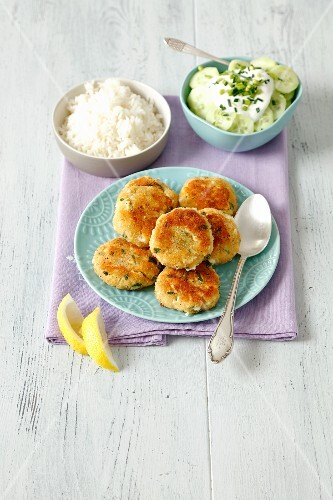 Bread fritters with rice and a cucumber salad