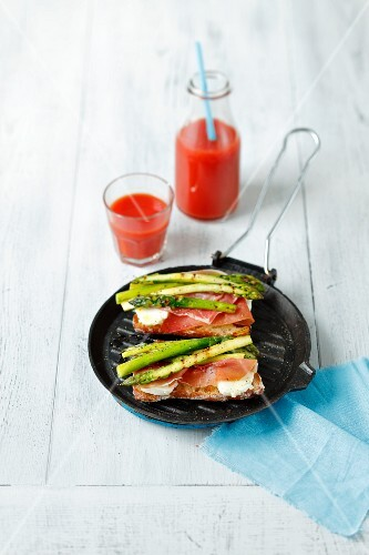 Ciabatta bread with mozzarella, ham and grilled asparagus